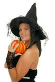 Witch. Picture of witch holding a pumpkin Stock Photos
