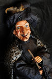 Witch. Puppet witch portrait on black background Stock Photos