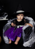 Witch. Is a baby dressed as a witch for Halloween royalty free stock photography