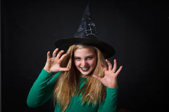 Witch. Girl masquerade as bad witch Royalty Free Stock Photography