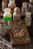 Witch apothecary jars magic potions book halloween decoration Royalty Free Stock Photos
