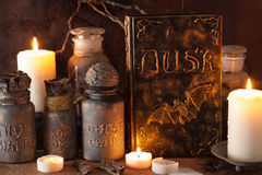 Witch apothecary jars magic potions book halloween decoration.  royalty free stock photography
