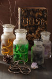 Witch apothecary jars magic potions halloween decoration Stock Photos