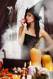 Witch with an apple Stock Photo