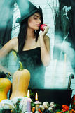 Witch with an apple, tinted Stock Photo