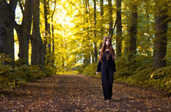 Witch in autumn forest Royalty Free Stock Photo