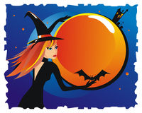 Witch with a bat Royalty Free Stock Image