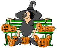 Witch on a bench Stock Photo