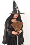 Witch with big hat Royalty Free Stock Photography