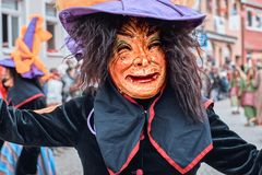 Witch with big hat looks into the camera. royalty free stock photography