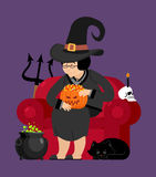 Witch with black cat. Halloween character. Skull and pot magic p Stock Photo