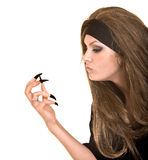 Witch in black costume and long hair with finger. Royalty Free Stock Photography