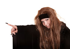 Witch in black costume and long hair point Royalty Free Stock Images