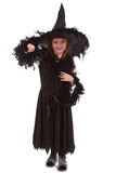 Witch in black dress and hat Stock Photo