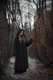 Witch in a black dress stock photos