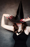 Witch with black hat and long nails Stock Image