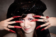 Witch with black turban and long nails Stock Photos