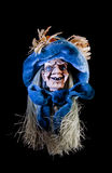 The witch. Witch with blue hat isolated over black stock photography