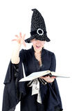 Witch with book Stock Photos
