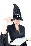 Witch with book Stock Photography