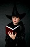 Witch Book. Women in witch costume with small book Royalty Free Stock Image