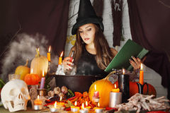 Witch with a book Royalty Free Stock Images