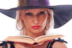 Witch with book Stock Photo