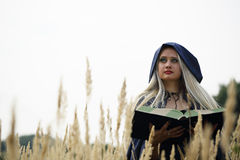 Witch with a book Royalty Free Stock Photography