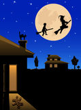 Witch and the boy fly Stock Images