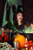 Witch brews a potion Royalty Free Stock Photography