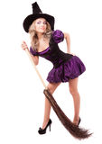Witch with a broom stock images