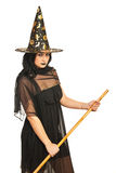 Witch with broom Stock Photos