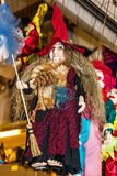 Witch with broom, marionette - traditional souvenir doll in Prag Stock Photo