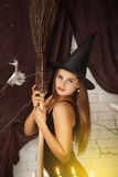Witch with a broom Royalty Free Stock Photo