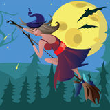 Witch on a broomstick in the air. Witch on a broom against the moon Royalty Free Stock Images