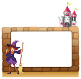 A witch with a broomstick in front of an empty template Royalty Free Stock Photography
