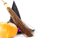 Witch broomstick, pumpkin and hat Stock Photography
