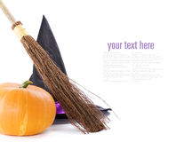 Witch broomstick, pumpkin and hat. Isolated on white background (with sample text royalty free stock photo