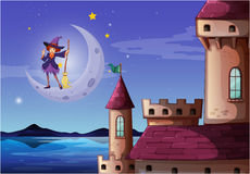 A witch with a broomstick standing near the castle Royalty Free Stock Photography