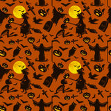 Witch on a broomstick under  full moon with skeletons and pumpkins to the cemetery where the crows fly over the crosses Stock Photo