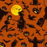 Witch on a broomstick under  full moon with skeletons and pumpkins to the cemetery where the crows fly over the crosses. Witch on a broomstick under a full moon Stock Photo