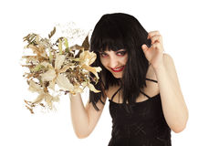 Witch with bunch of dry flowers looking crafty. Isolated on white Royalty Free Stock Photo