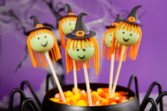 Witch cake pops. Round-shaped mini cakes dipped in chocolate and decorated with fondant royalty free stock photo