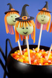 Witch cake pops. Halloween cake pops. Round-shaped mini cakes dipped in chocolate and decorated with fondant Stock Images