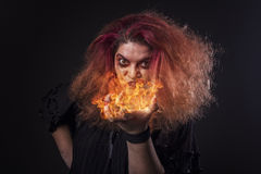 Witch casting a fire spell Royalty Free Stock Photography