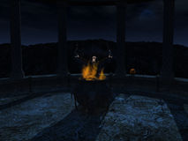 Witch casting a spell at night. Royalty Free Stock Image