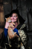 Witch with a cat Royalty Free Stock Image