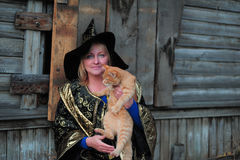 Witch with a cat Stock Photography