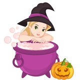 Witch with Cauldron Royalty Free Stock Photography