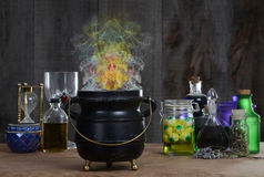 Witch cauldron with smoke. Closeup of a Witch cauldron with colorful smoke Stock Photo